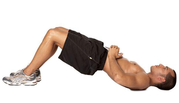 Beckenheben mit Gewicht auf dem Bauch
