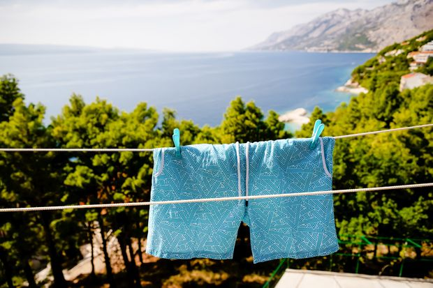 Blue,Men's,Swim,Shorts,Hanging,On,The,Clothesline,On,The
