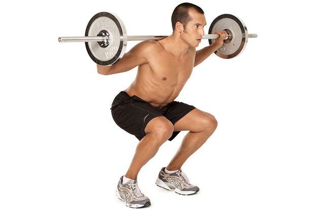 Kniebeugen mit Langhantel und gehobenen Fersen
