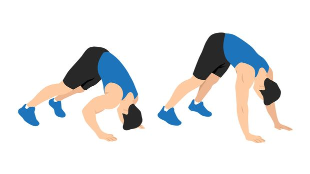 Man,Doing,Dive,Bomber,Push,Ups,In,The,Outdoor,Gym