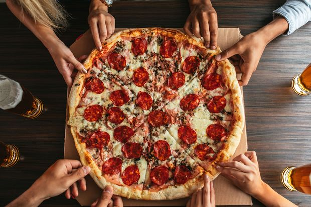 Pizza solltest du nicht vor dem Training essen